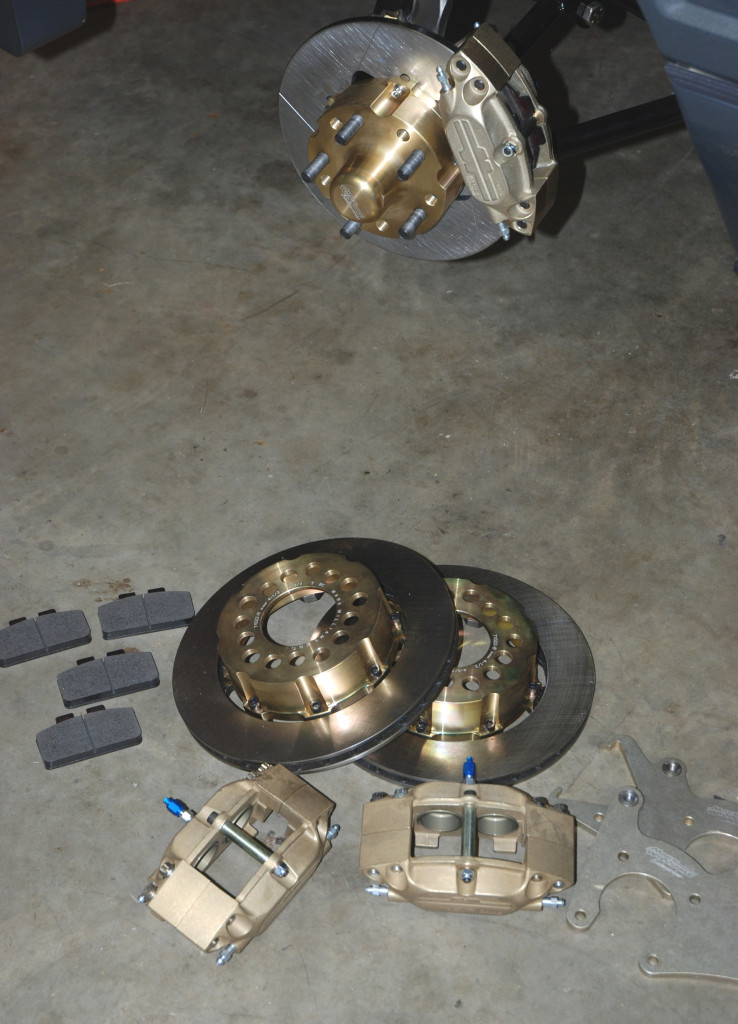 This is a complete brake package from Mark Williams. The front brake system is based upon a four piston caliper and a solid rotor while the rear setup is one of M-W's Pro Street packages. It includes a four piston caliper and a vented rotor.  Not shown is a single piston mechanical caliper.