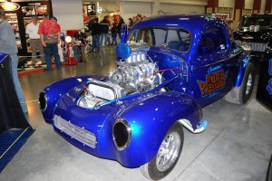 """Survived Under Pressure"" drag racing blue Willys coupe."