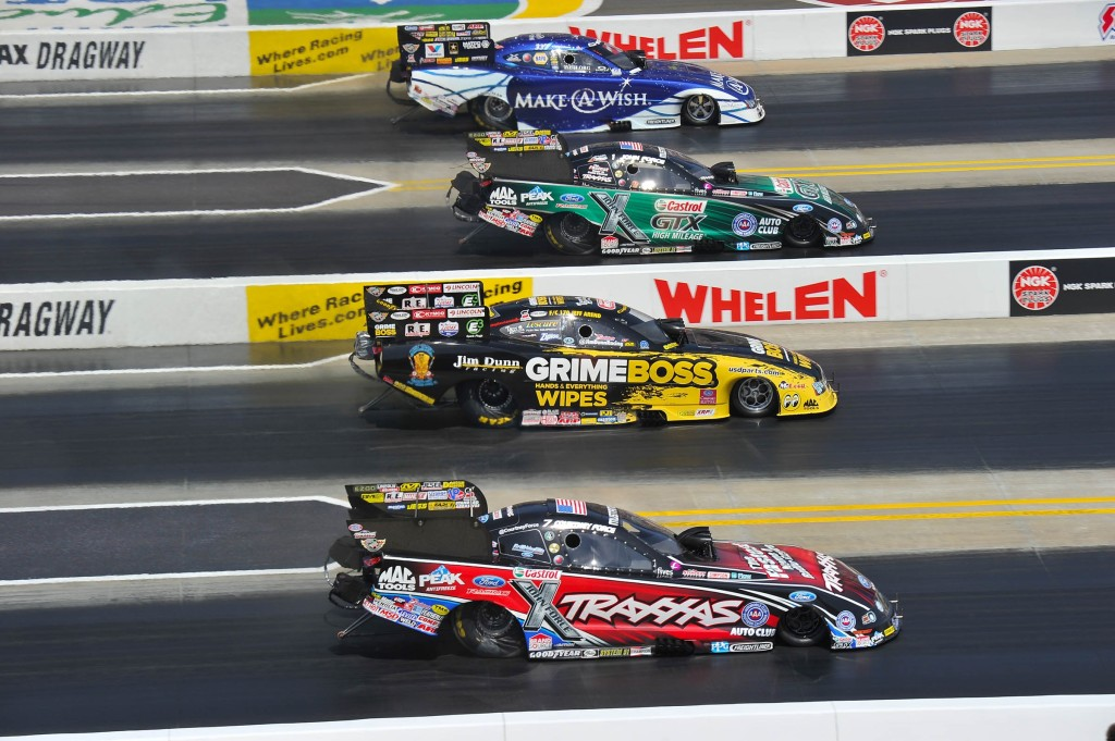 Photo: Ron Lewis Photography/JFR Racing unny Car racing was never tighter than at the 4-Wide Nationals with John Force and Tommy Johnson, Jr. taking round wins