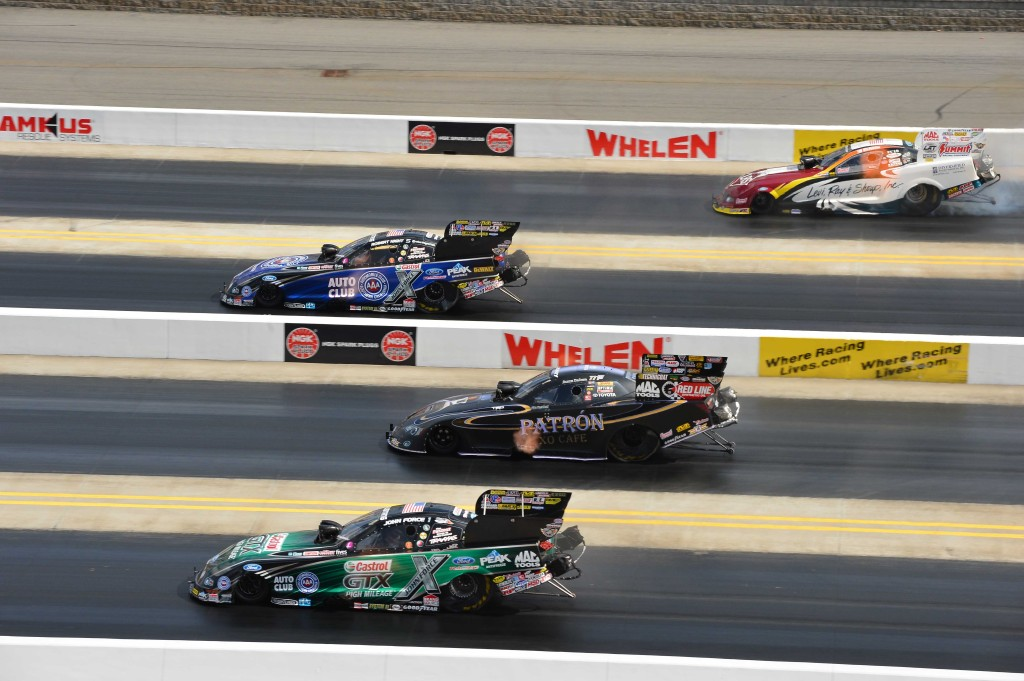 Photo: Gary Nastase Photography/JFR Racing Robert Hight sprints to the finish line in his AAA Ford Mustang over 4-Wide title contenders, John Force, Alexis DeJoria and Tim Wilkerson.