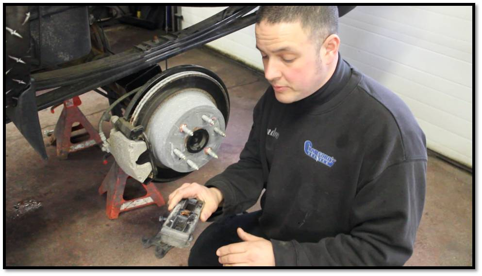 Andrew recommends performing this process one side at a time to keep the axle from rolling over and moving too much. Good advice, as you don't want the whole thing wandering and disturbing the u-joint and driveshaft placement while you remove the u-bolts and factory block spacer.