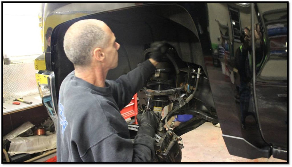Vinnie, Crawford's master mechanic, begins the install.