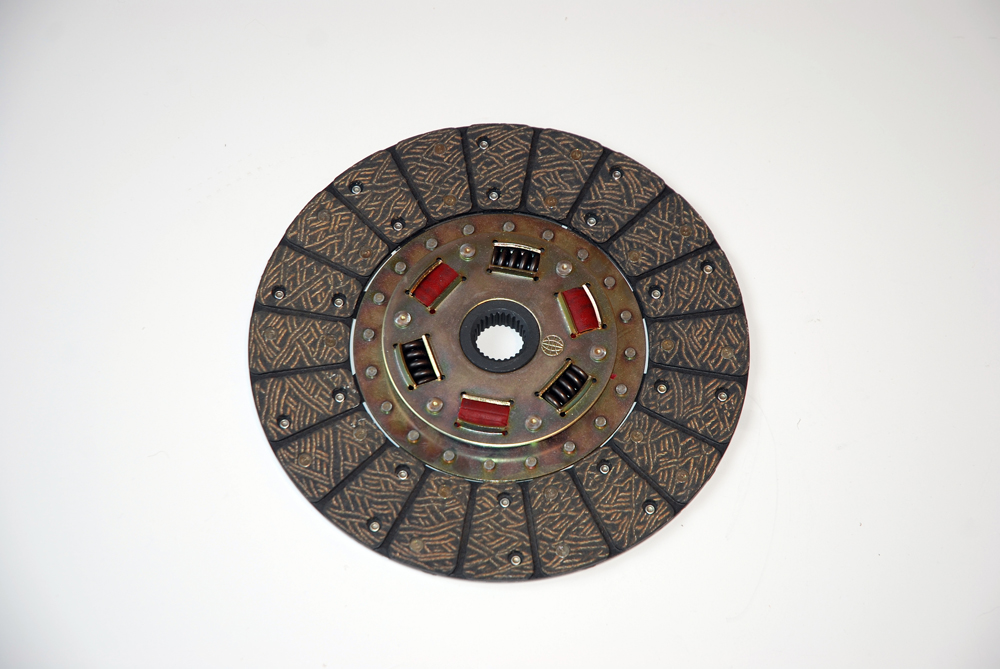 "Here's where modern technology meets old school: The ""rag"" or disc looks pretty conventional in the first photo – on the pressure plate side, it features an organic bonded, riveted face and sprung hub. Flip it over to the flywheel side and you'll find the disc has a ceramic (segmented) puck bonded to the face."