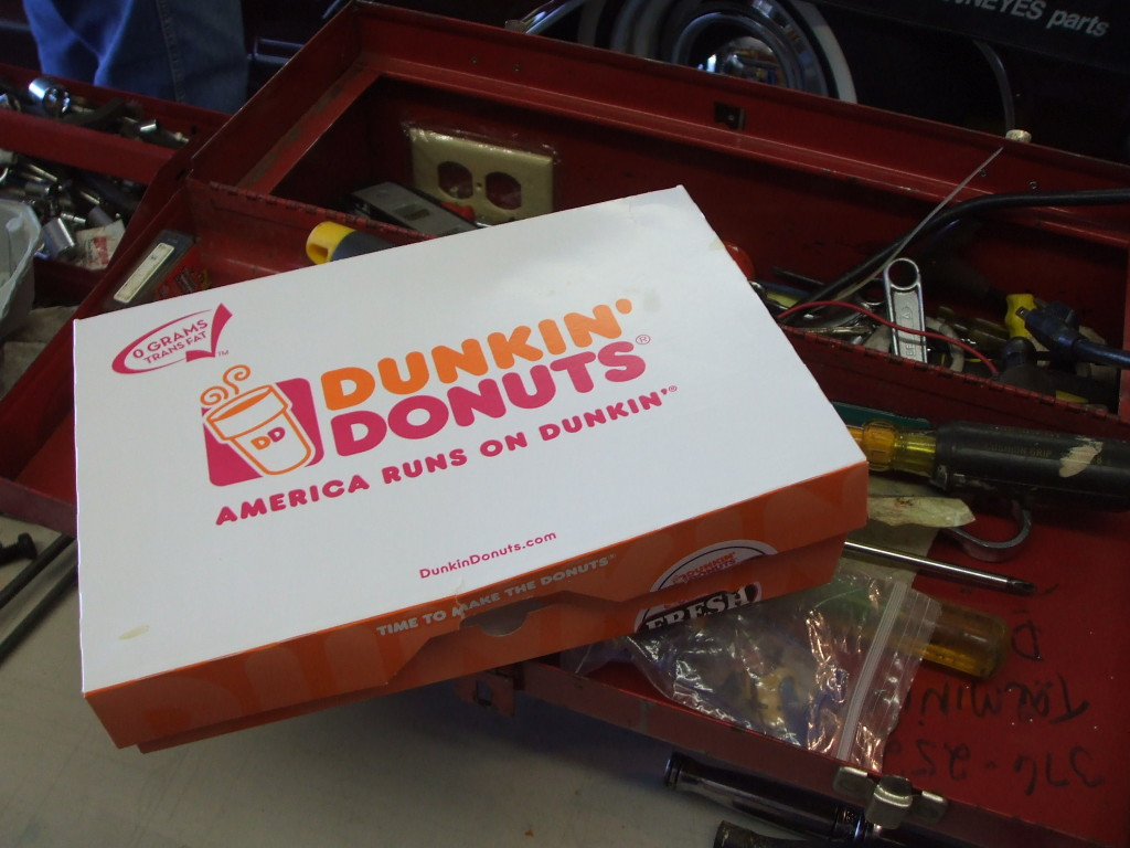 """While I clean and paint, the crew huddles around a box of donuts for """"inspiration."""""""