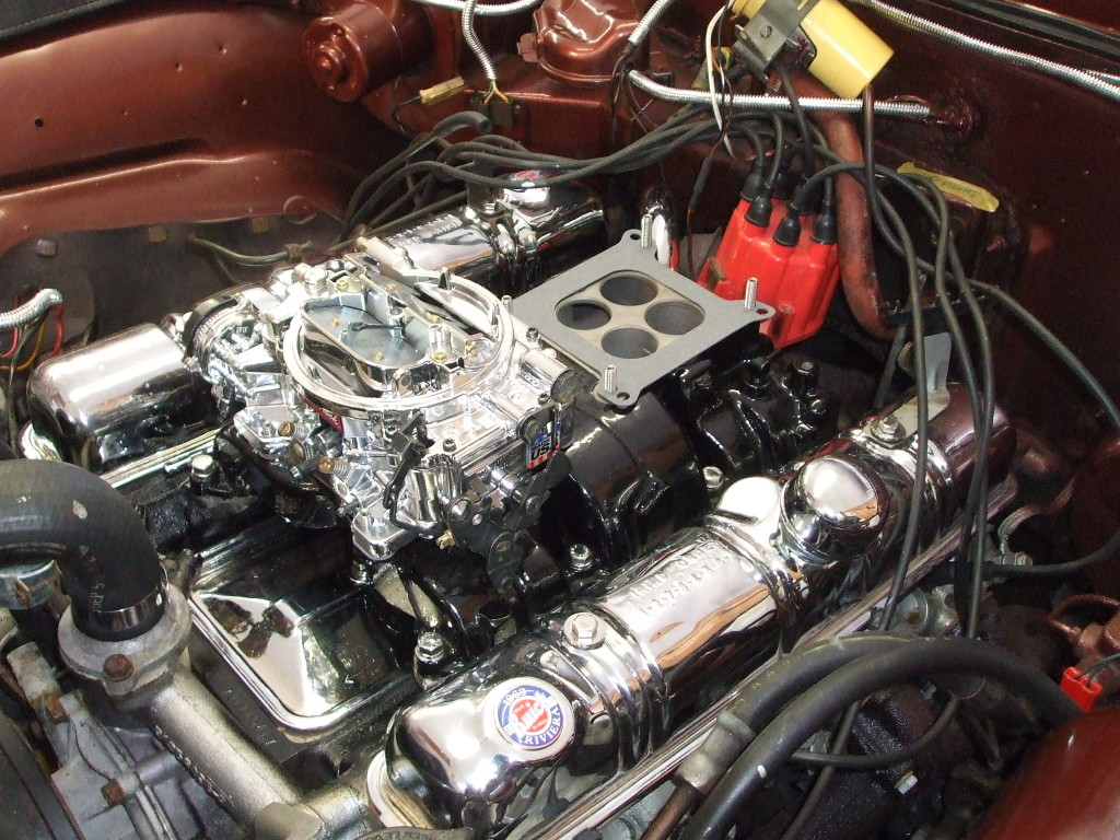 Now we install the gaskets and the Edelbrock carburetors.