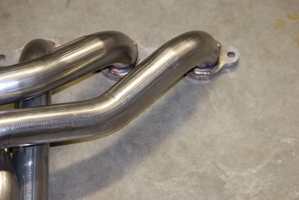 Compared to the sonic wave, the exhaust pulse travels at a more leisurely 300 or so feet per second. The header manufacturer has to take both forms of potential scavenging into consideration when building a header.