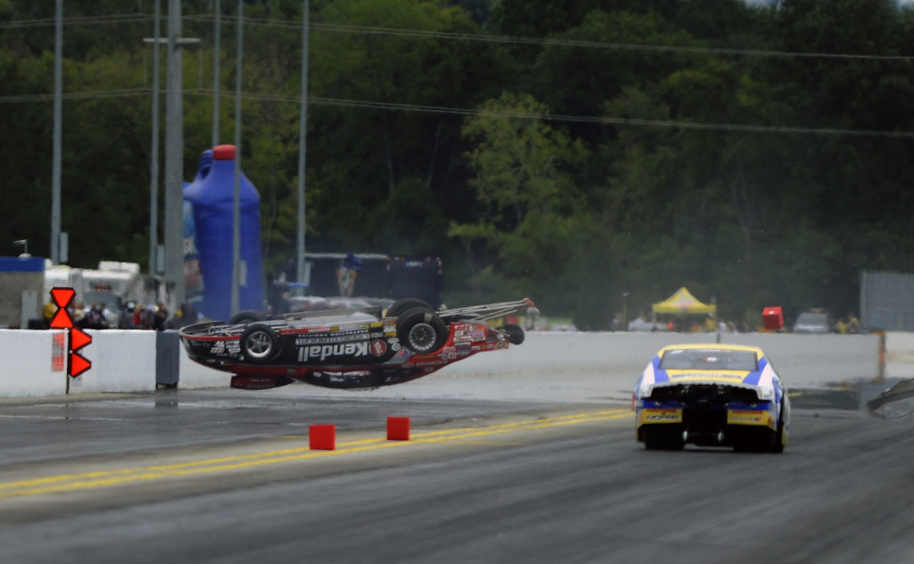 V Gaines Dart flips as Allen Johnson skids. Luckily, Gaines walked away from the accident.