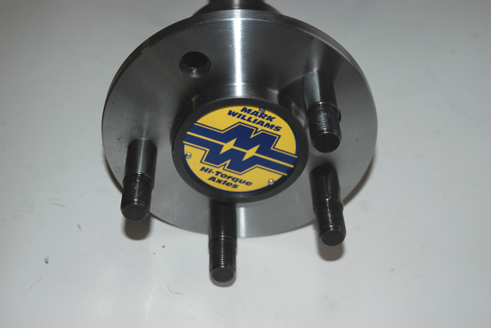 This is the flange side of the Pro Street axle (it's being fitted with Drive Studs in this photo – we'll spend some time on these down the road). Different applications mandate different flanges. A Pro Street piece will be thicker (heavier) than a dedicated drag race axle (for example, no worries about curbs on the strip).