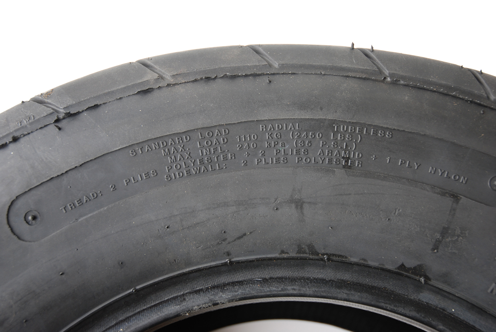 The sidewall of a DOT tire includes some important information.  For example, this M&H tire shows the load range; the maximum tire load (2450 pounds) and the side wall and tread construction (2 ply and 4 ply respectively).  You'll also find the tire is directional (with an arrow pointing toward rotation).