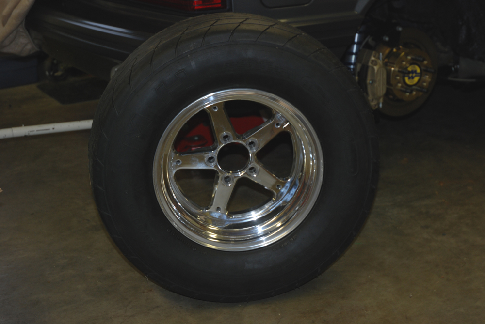 This 15X8 Champion Wheel weighs in at 13.7 pounds. Yes, you can get a lighter wheel but honestly there's a point where you trade a pounds for reliability (don't believe it?  Watch a set of seriously light wheels as they're mounted with tires. You can physically see the rim deflect).
