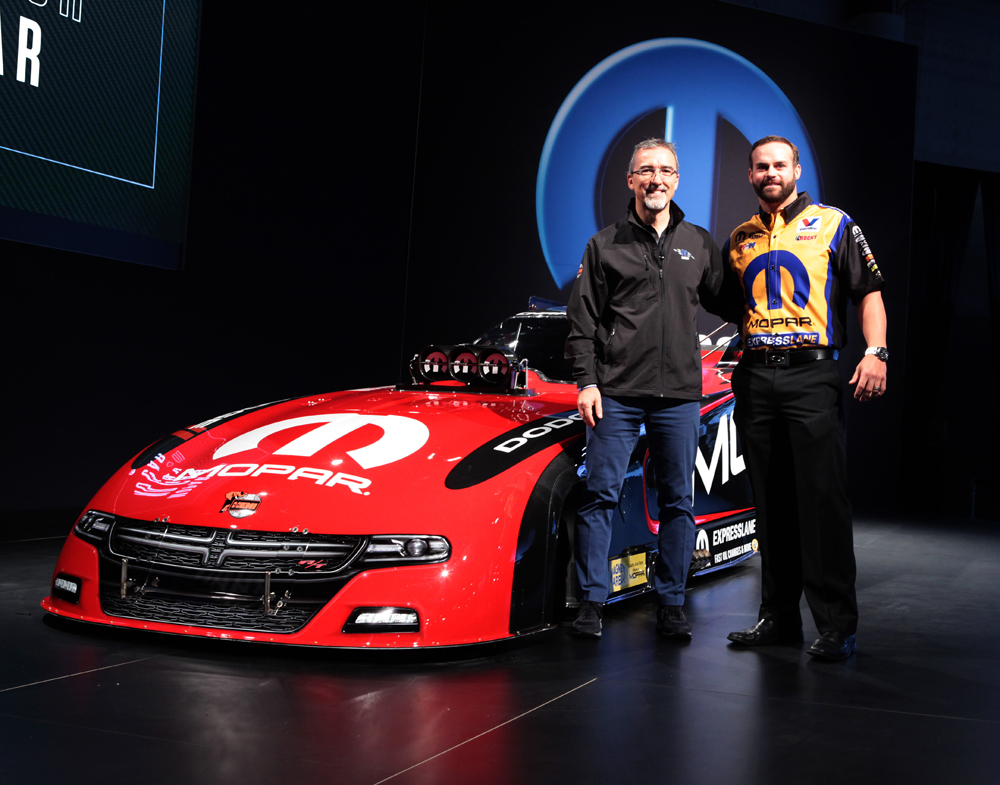 Fiat Chrysler Automobiles' (FCA) Mopar and Dodge brands along with Matt Hagan, reveal a new 2015 Mopar Dodge Charger R/T Funny Car drag racing vehicle at the Specialty Equipment Market Association (SEMA) show in Las Vegas.