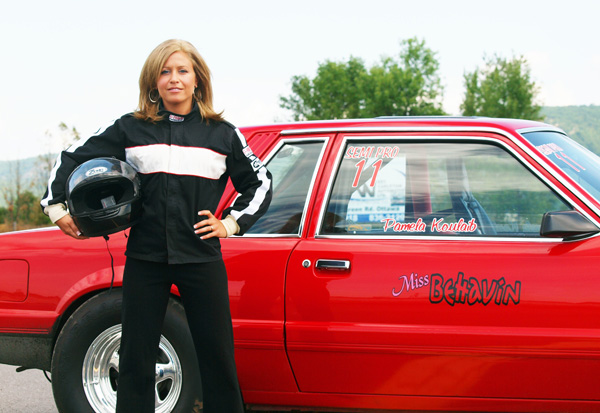 Pamela Koulaib next to her drag car.