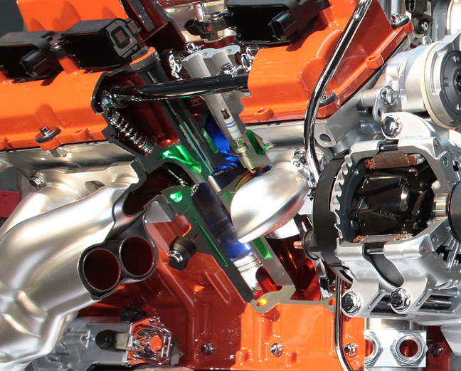 When developing the engine, the engineers realized that a significant change in the coolant circuit was in order. This change was required in order to manage the Hellcat's increased thermal output. What this means is that the water jackets (green areas) are longer, and continue to a level that is directly across from the piston crown's bottom dead center.