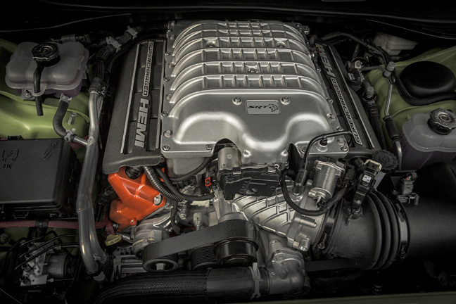 "The 2,380 cc blower uses integral charge coolers that keep inlet-air temperatures below 140-degrees Fahrenheit. Boost is regulated to around 11-1/2 psi. This new supercharger is ""sealed for life"", which means that you never have to change the synthetic oil, has a drive ratio of 2.36:1 and a maximum speed of 14,600 rpm. In reality, the Hellcat supercharger is capable of pushing six gallons of air into the engine—in one minute, and the engine uses 80 of its 707 horsepower, just to drive the supercharger."