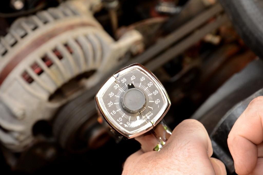 Finally, to even think about adjusting the timing advance in your distributor, you will need either a timing light with a dial on the back of it, timing tape on your damper/balancer, or a damper/balancer with degree marks.