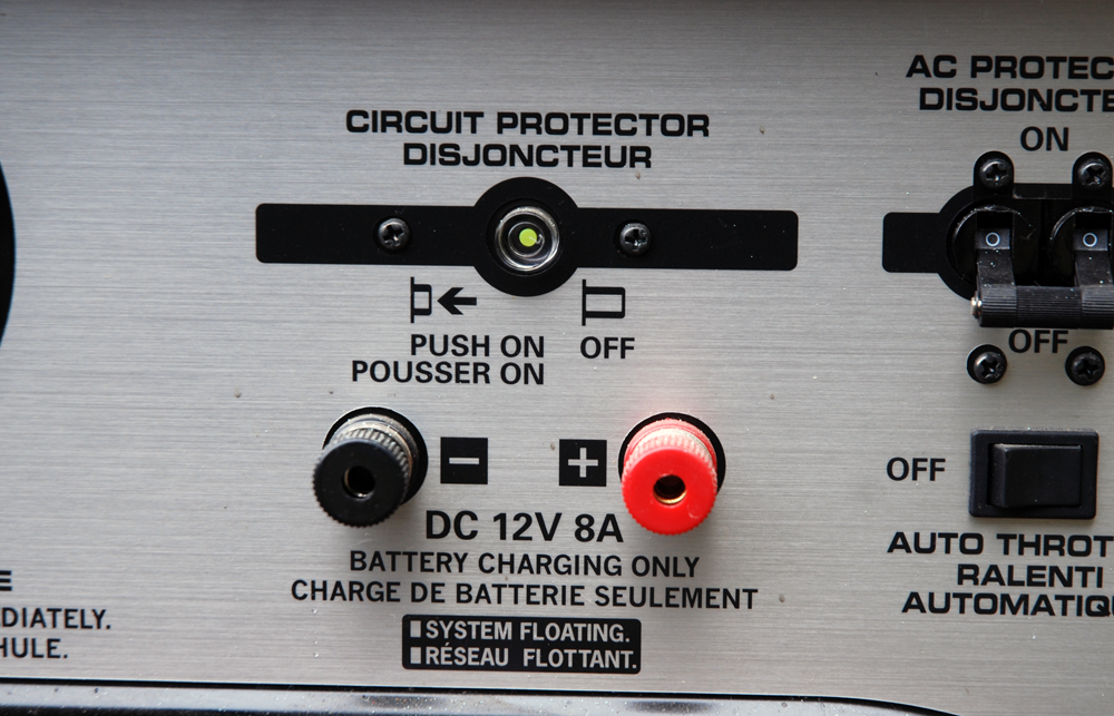Some generators have DC capability.  Others don't.  Having DC capability means that you can directly charge a battery from the generator.  If the generator doesn't have this feature,  you'll have to plug a battery charger into the generator, then link the charger to the battery(s).  In many cases, the larger generators (in the 3000 watt range) do not have DC capability as standard equipment (although some have DC capability listed as an option).  Typically, the smaller portable generators used at drag strips with DC capability provide 12 volts and 8.3 to 10 amps of output. In most cases you can't use AC power and DC power simultaneously.