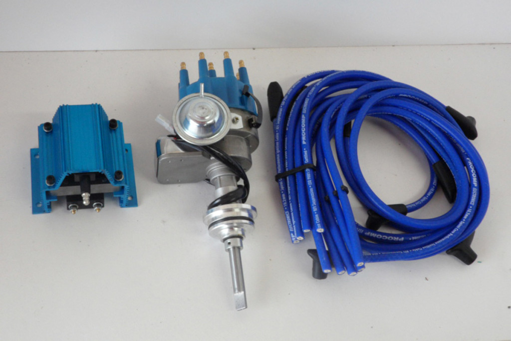 A performance standard points/breaker-type ignition upgrade consists of these items: New coil, distributor with cap and rotor, and new wires.
