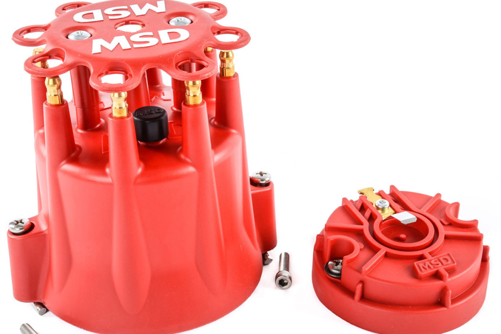 The ignition spark comes from the ignition coil into the center tower of the distributor cap. The spark travels through the cap and to the rotor underneath. The spark then travels along the conductor on the rotor to the plug tower corresponding to the correct spark plug.