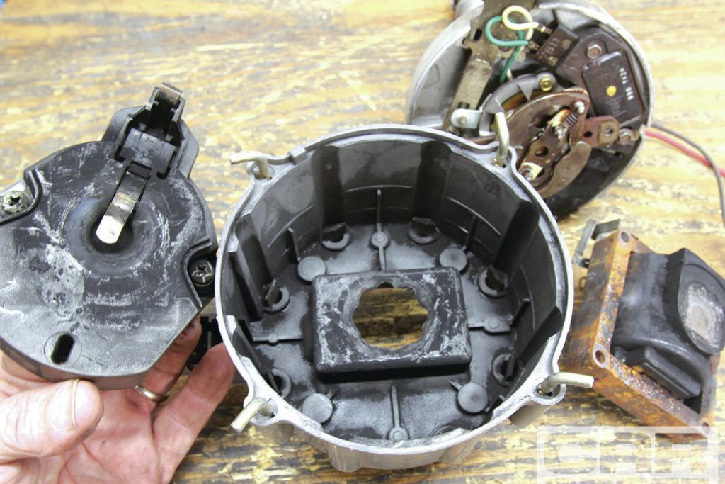 This image shows a cap and rotor that is in dire need of being changed. Pitting on the cap and rotor terminals can easily be seen.