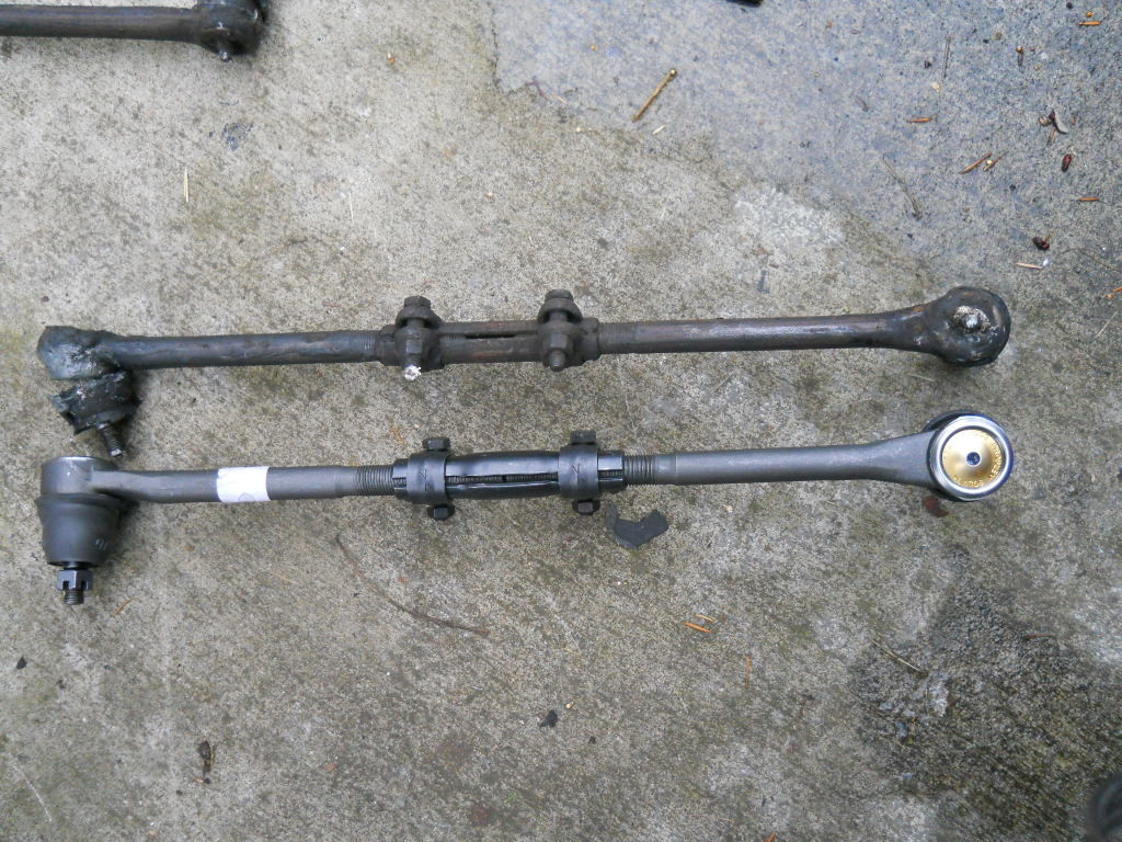 Inner and outer tie rod ends from an older GTO. This image perfectly shows the two nuts on the connecting sleeve and the sleeve that is rotated to adjust toe.