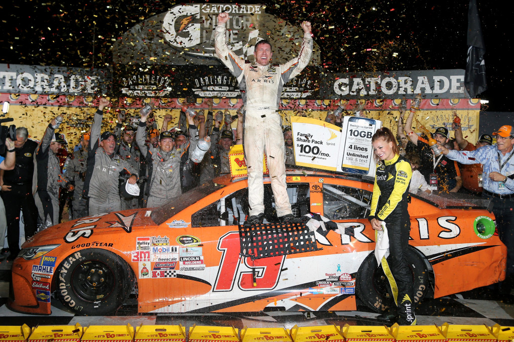 Carl Edwards celebrates in Victory Lane after winning the NASCAR Sprint Cup Series Bojangles' Southern 500 at Darlington Raceway on September 6, 2015 in Darlington, South Carolina.