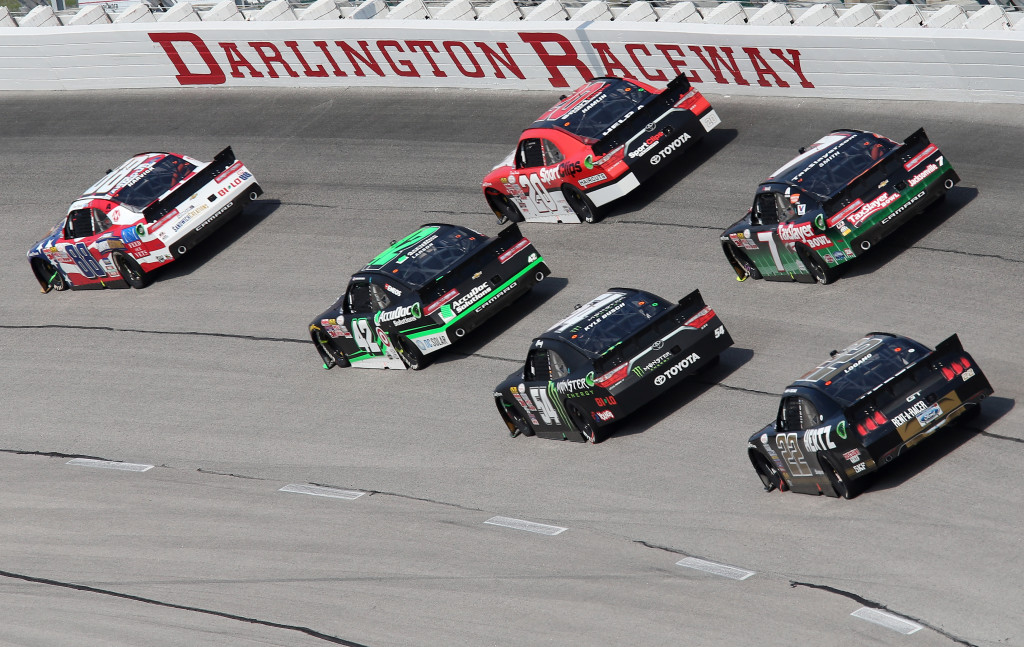 Kevin Harvick, driver of the #88 Armour Sandwich Creations Chevrolet, leads a pack of cars during the NASCAR XFINITY Series VFW Sport Clips Help A Hero 200 at Darlington Raceway.