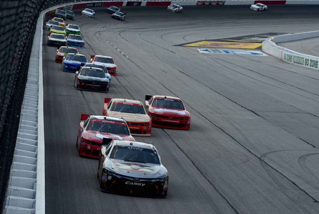 JJ Yeley, driver of the #28 JGL Racing Toyota, leads a pack of cars during the NASCAR XFINITY Series VFW Sport Clips Help A Hero 200 at Darlington Raceway