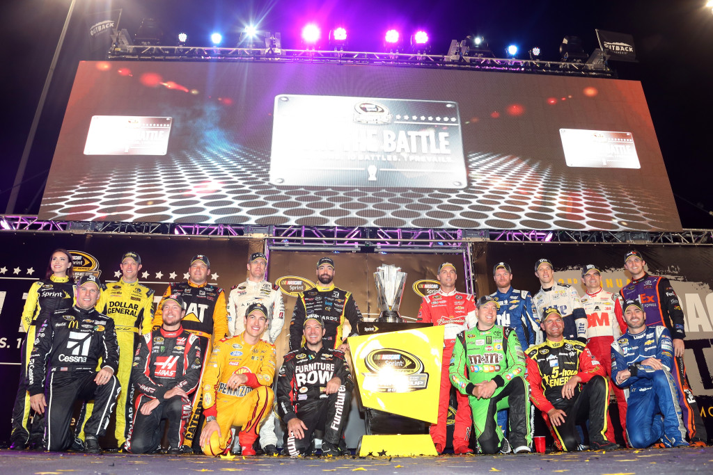 (Back row L-R) Matt Kenseth, driver of the #20 Dollar General Toyota, Ryan Newman, driver of the #31 Caterpillar Chevrolet, Carl Edwards, driver of the #19 ARRIS Toyota, Paul Menard, driver of the #27 Libman/Menards Chevrolet, Kevin Harvick, driver of the #4 Budweiser/Jimmy John's Chevrolet, Dale Earnhardt Jr., driver of the #88 Nationwide Chevrolet, Brad Keselowski, driver of the #2 Miller Lite Ford , Jeff Gordon, driver of the #24 3M Chevrolet, Denny Hamlin, driver of the #11 FedEx Express Toyota, (front row L-R) Jamie McMurray, driver of the #1 Cessna Chevrolet, Kurt Busch, driver of the #41 Haas Automation Chevrolet, Joey Logano, driver of the #22 Shell Pennzoil Ford, Martin Truex Jr., driver of the #78 Furniture Row/Visser Precision Chevrolet, Kyle Busch, driver of the #18 M&M's Crispy/American Heritage Chocolate Toyota , Clint Bowyer, driver of the #15 5-hour Energy Toyota, and Jimmie Johnson, driver of the #48 Lowe's Chevrolet, pose for a photo after making the Chase for the Sprint Cup.