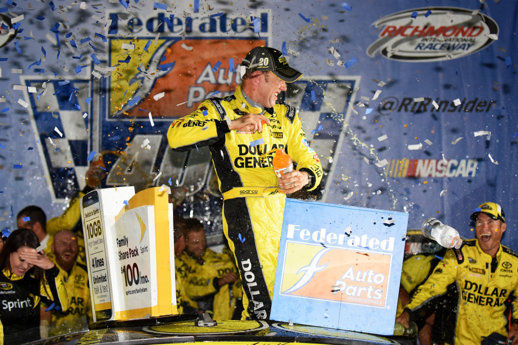 Matt Kenseth, driver of the #20 Dollar General Toyota, celebrates in Victory Lane after winning the NASCAR Sprint Cup Series Federated Auto Parts 400 at Richmond International Raceway.