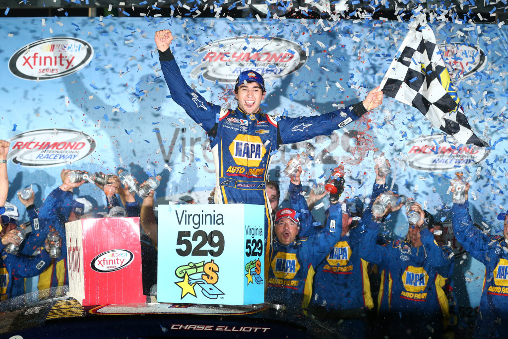 Chase Elliott, driver of the #9 NAPA Auto Parts Chevrolet, celebrates in Victory Lane after winning the NASCAR XFINITY Series Virginia529 College Savings 250 at Richmond International Raceway.