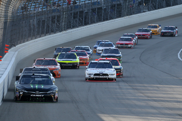Kyle Busch, driver of the #54 Monster Energy Toyota, leads a pack of cars during the NASCAR XFINITY Series FURIOUS 7 300 at Chicagoland Speedway