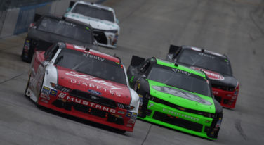Regan Smith Fights off JGR  Teammates