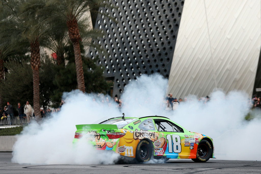 LAS VEGAS, NV - DECEMBER 03:  NASCAR Sprint Cup Champion Kyle Busch does a burn out during the NASCAR Victory Lap on the Las Vegas Strip on December 3, 2015 in Las Vegas, Nevada.  (Photo by Chris Graythen/NASCAR via Getty Images)