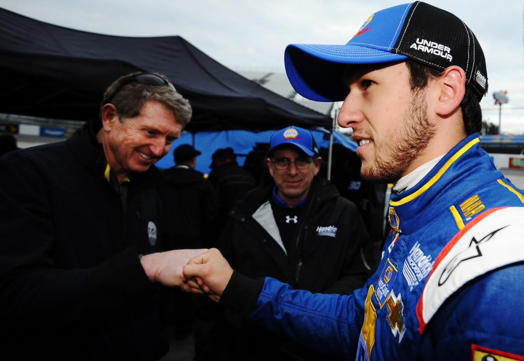 MARTINSVILLE, VA - MARCH 27:  NASCAR Hall of Famer Bill Elliott (left) congratulates his son Chase Elliott, driver of the #25 NAPA AUTO PARTS Chevrolet, after qualifying for the NASCAR Sprint Cup Series STP 500 at Martinsville Speedway on March 27, 2015 in Martinsville, Virginia. This will mark Chase Elliott's first NASCAR Sprint Cup Series start.  (Photo by Rainier Ehrhardt/NASCAR via Getty Images)