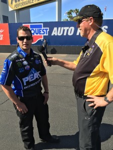 Jon Schaffer does an interview on the starting line after tuning John Force to the final round.