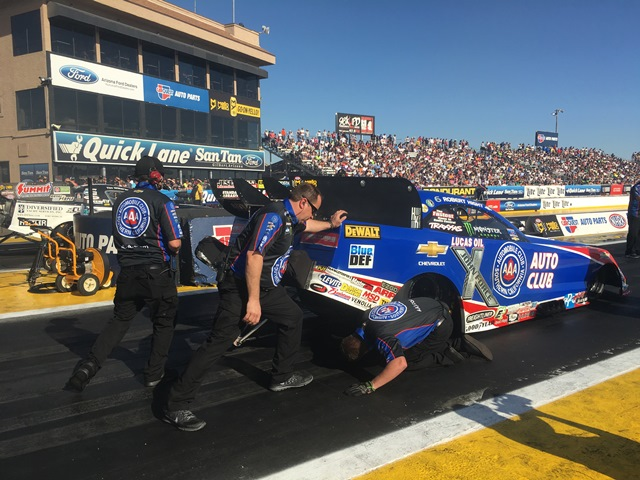 Robert Hight is pushed by crew members after his burnout during eliminations.