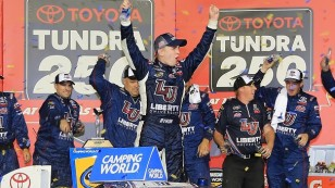 KANSAS CITY, KS - MAY 06:  William Byron, driver of the #9 Liberty University Toyota, celebrates in Victory Lane during the NASCAR Camping World Truck Series Toyota Tundra 250 at Kansas Speedway on May 6, 2016 in Kansas City, Kansas.  (Photo by Jerry Markland/Getty Images)