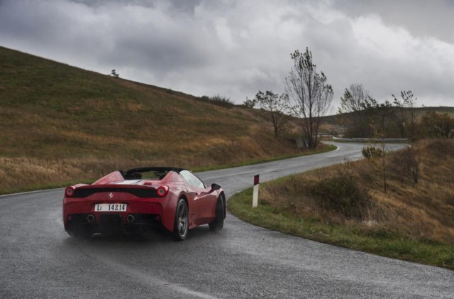 Balancing a car like this on a wet road is best done with a normally-aspirated engine, like this 458's V8.