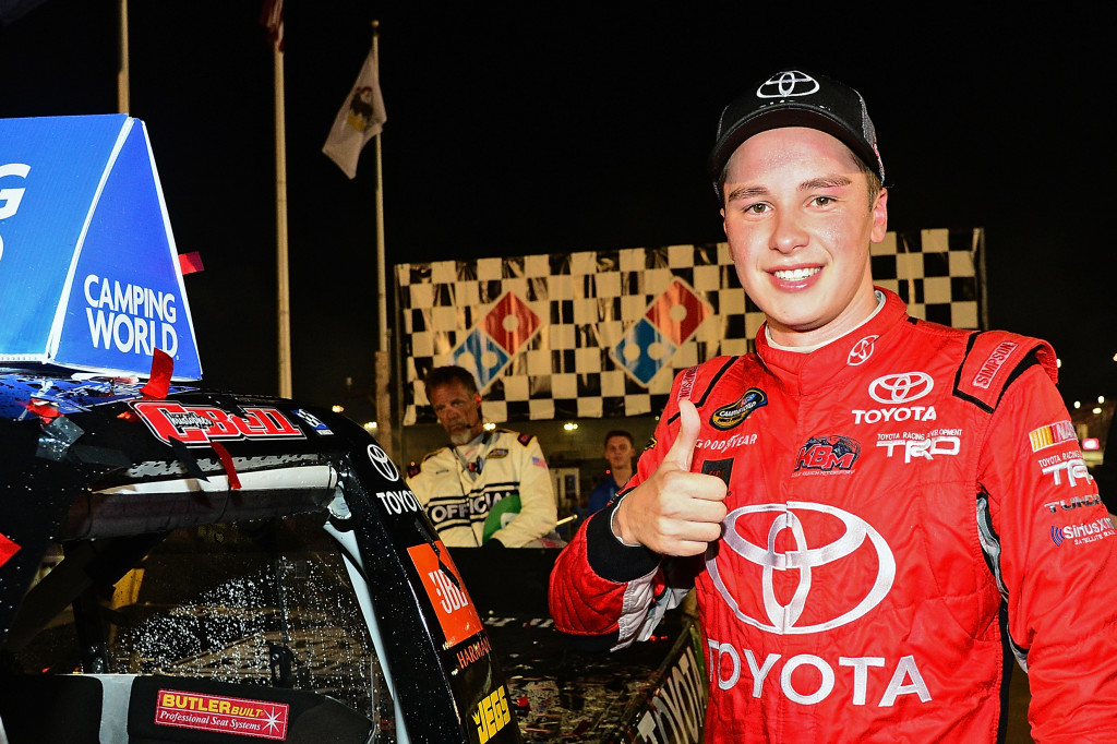 Christopher Bell, driver of the #4 Toyota Toyota, puts the winner sticker on his truck in victory lane after winning the NASCAR Camping World Truck Series Drivin' for Linemen 200 at Gateway Motorsports Park on June 25, 2016 in Madison, Illinois. (Photo by Jeff Curry/NASCAR via Getty Images)