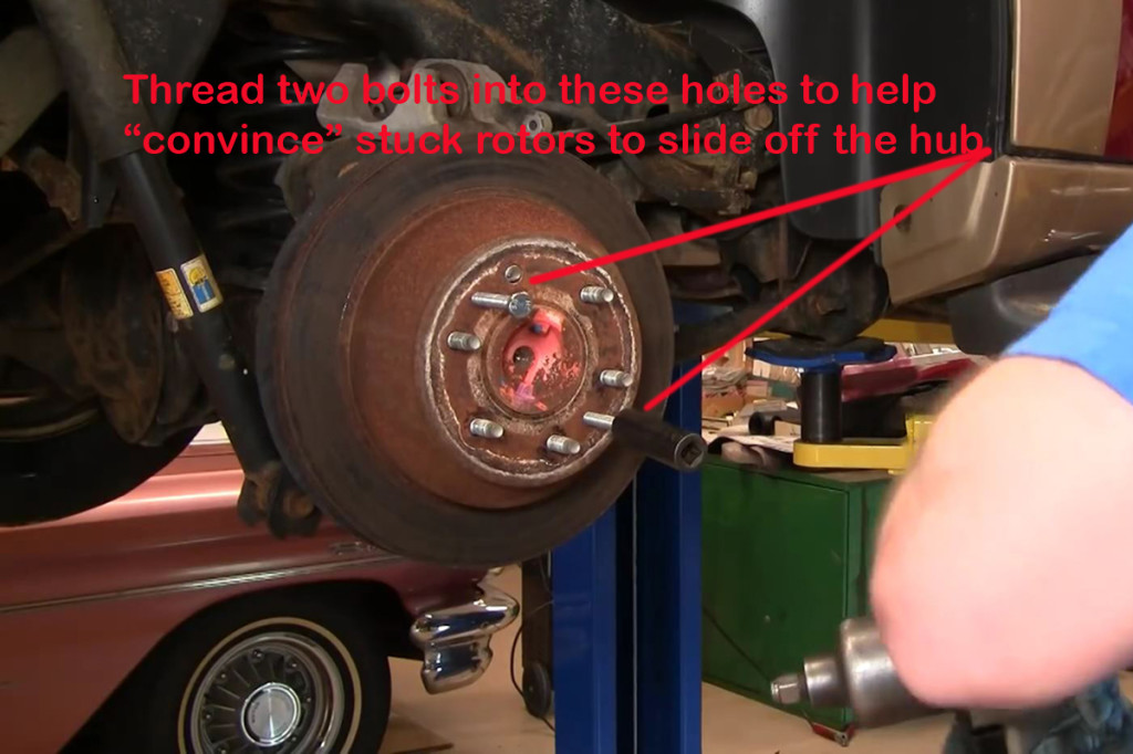 "Most rotors will ""walk"" right off. However, for those that don't, you can use two screws to push the rotor off."