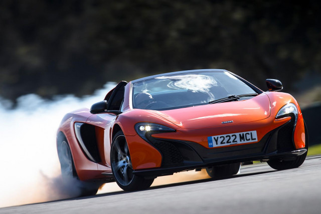 The McLaren 650's 500 lb/ft of torque comes in one big rush, and easily lights up the rear tires.