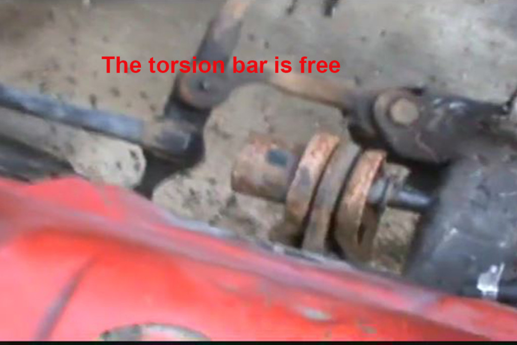 This image shows the front end of the torsion bar after it's been removed from the front hex socket. Image from screenshot.