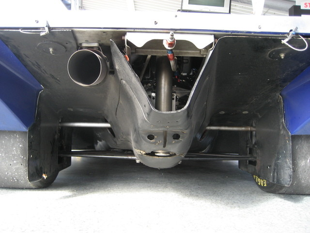 The Porsche 962's venturi tunnels expand air towards the rear of the car, resulting in a low pressure situation, resulting in downforce.