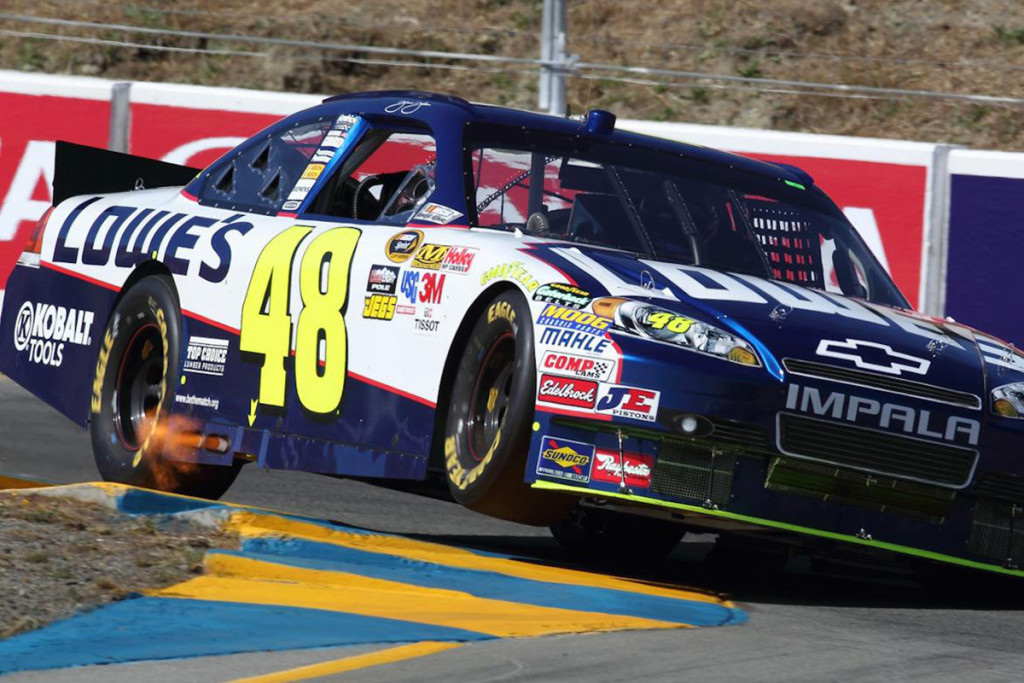 This image of NASCAR driver Jimmie Johnson at California's Infineon Raceway is an exaggerated illustration of the concept of lateral traction transfer. The heavy sway bar his car has in the rear causes the inside front wheel to lift, transferring traction to the wheel that's losing it-the inside rear wheel. This allows his car to get a better launch off and acceleration out of the corner. Image courtesy caranddriver.com