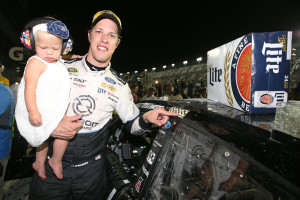 DAYTONA BEACH, FL - JULY 02: Brad Keselowski, driver of the #2 Detroit Genuine Parts Ford, poses with the winner's decal while holding daughter Scarlett in Victory Lane after winning the NASCAR Sprint Cup Series Coke Zero 400 Powered By Coca-Cola at Daytona International Speedway on July 2, 2016 in Daytona Beach, Florida.  (Photo by Sean Gardner/NASCAR via Getty Images) *** Local Caption *** Brad Keselowski