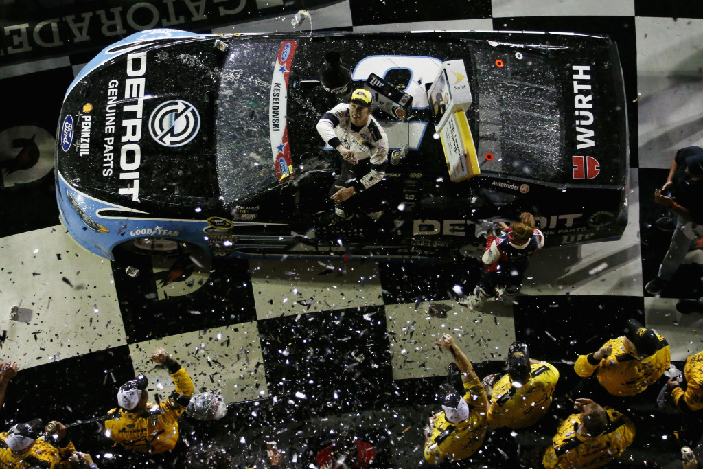 DAYTONA BEACH, FL - JULY 02: Brad Keselowski, driver of the #2 Detroit Genuine Parts Ford, celebrates in Victory Lane after taking the checkered flag in the NASCAR Sprint Cup Series Coke Zero 400 Powered By Coca-Cola at Daytona International Speedway on July 2, 2016 in Daytona Beach, Florida.  (Photo by Matt Sullivan/Getty Images) *** Local Caption *** Brad Keselowski