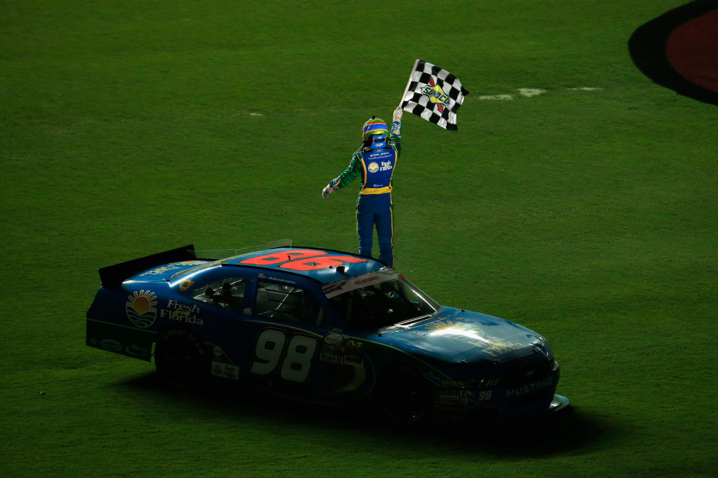 DAYTONA BEACH, FL - JULY 01: Aric Almirola, driver of the #98 Fresh From Florida Ford, celebrates with the checkered flag on the infield after winning the NASCAR XFINITY Series Subway Firecracker 250 at Daytona International Speedway on July 1, 2016 in Daytona Beach, Florida.  (Photo by Chris Trotman/Getty Images)