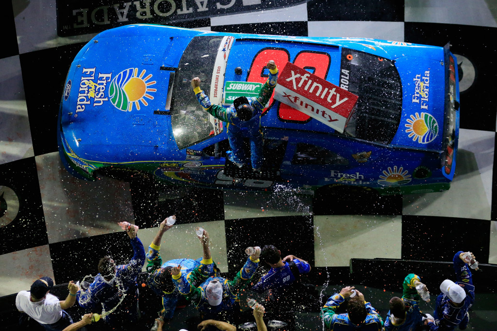 DAYTONA BEACH, FL - JULY 01: Aric Almirola, driver of the #98 Fresh From Florida Ford, celebrates with champagne in Victory Lane after winning the NASCAR XFINITY Series Subway Firecracker 250 at Daytona International Speedway on July 1, 2016 in Daytona Beach, Florida.  (Photo by Chris Trotman/Getty Images)
