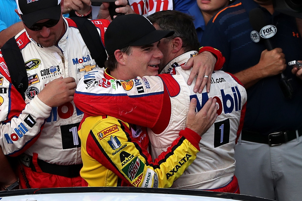 INDIANAPOLIS, IN - JULY 24:  (L-R) Jeff Gordon, driver of the #88 Axalta Chevrolet, hugs Tony Stewart, driver of the #14 Mobil 1/Chevy Summer Sell Down Chevrolet, after the NASCAR Sprint Cup Series Crown Royal Presents the Combat Wounded Coalition 400 at Indianapolis Motor Speedway on July 24, 2016 in Indianapolis, Indiana.  (Photo by Sean Gardner/NASCAR via Getty Images)