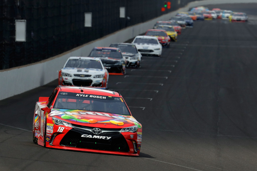 INDIANAPOLIS, IN - JULY 24:  Kyle Busch, driver of the #18 Skittles Toyota, races the NASCAR Sprint Cup Series Crown Royal Presents the Combat Wounded Coalition 400 at Indianapolis Motor Speedway on July 24, 2016 in Indianapolis, Indiana.  (Photo by Andy Lyons/Getty Images)